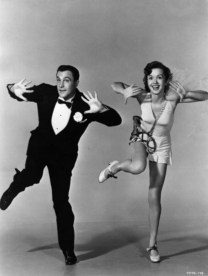 American actor-dancer Gene Kelly rehearsing with Debbie Reynolds for the MGM musical