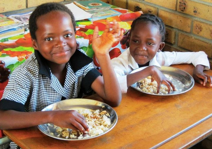 "Two children served by nonprofit <a href=""http://www.seedsoflight.org/"" target=""_blank"">Seeds of Light</a> in South Africa, w"