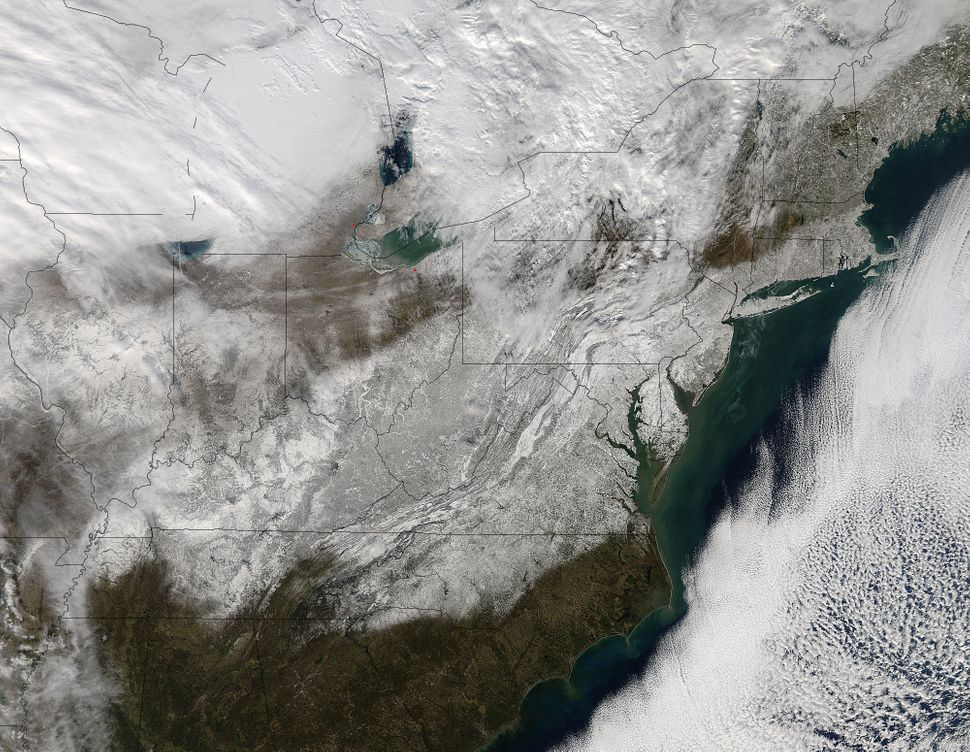 This image from NASA's Aqua satellite shows post-storm snow on the ground across the eastern U.S.on Jan. 24.
