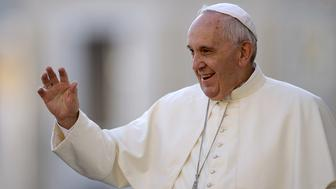 Pope Francis waves to pilgrims upon his arrival in St Peter's square at the Vatican on September 9, 2015, for his weekly general audience. In a letter to believers on September 8, the Argentinian pontiff said annulments would require approval by only one church tribunal, rather than two as currently. A streamlined procedure is to be introduced for the most straightforward cases and access to hearings will not cost anything, the letter states.     AFP PHOTO / FILIPPO MONTEFORTE        (Photo credit should read FILIPPO MONTEFORTE/AFP/Getty Images)