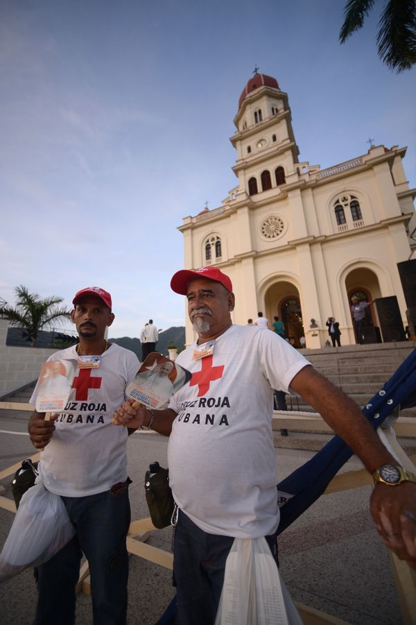 Members of the Cuban Red Cross wait for Pope Francis to arrive at the basilica to Our Lady of Charity of El Cobre, the patron