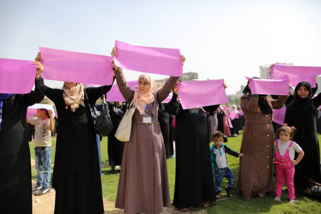 Palestinian women organize a demonstration to demand access to early screening for breast cancer in Gaza...