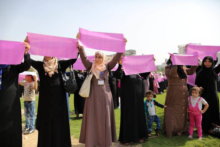 Palestinian women organize a demonstration to demand access to early screening for breast cancer in Gaza on Oct. 12, 2015.