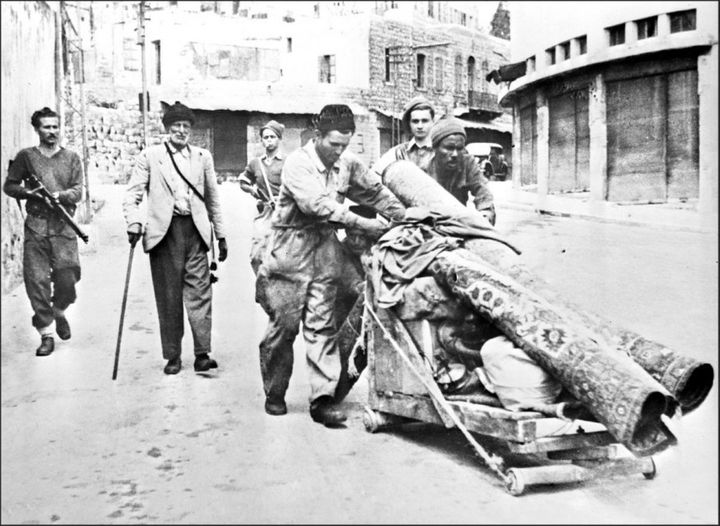 The Hagana (Zionist militia) force Palestinians out of Haifa at gunpoint in May 1948.
