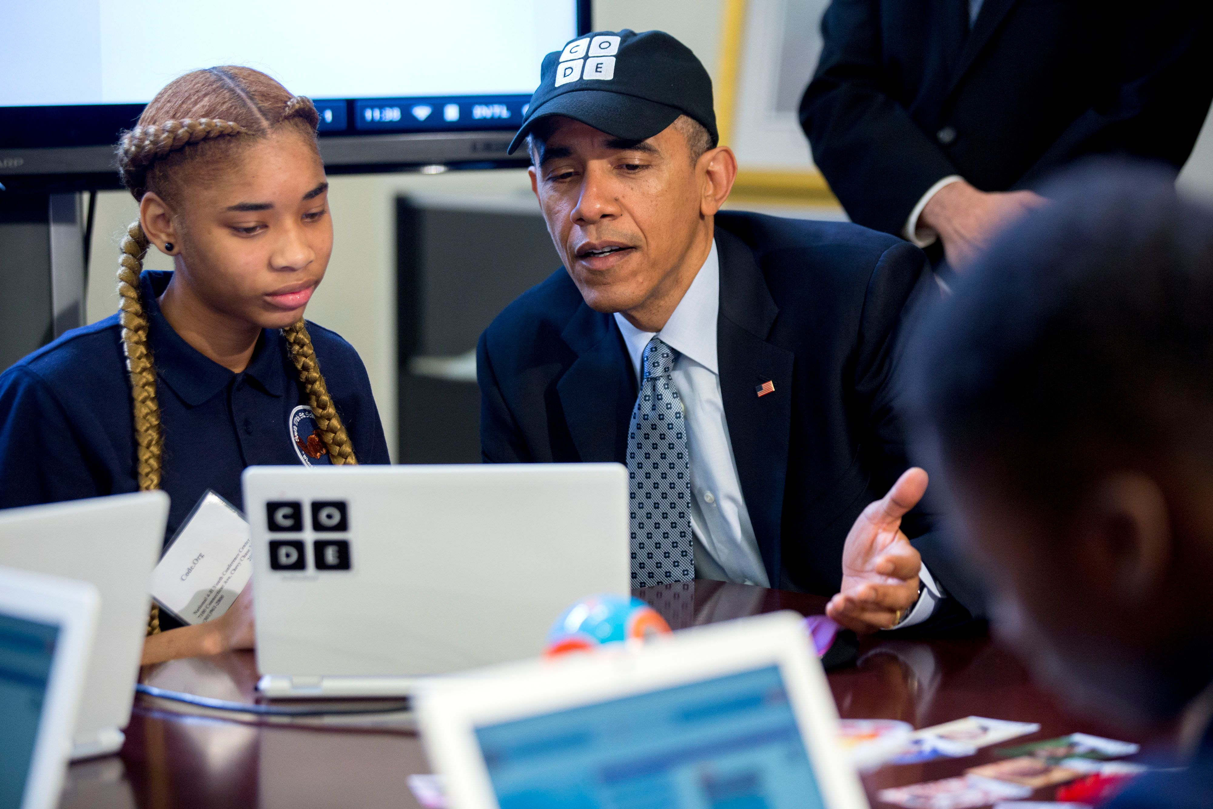 WASHINGTON, DC - DECEMBER 8:  U.S. President Barack Obama participates in an 'Hour of Code' event with middle-school students including Adrianna Mitchell in the Eisenhower Executive Office Building next to the White House on December 8, 2014 in Washington, DC.  The event is in honor of Computer Science Education Week. (Photo by Andrew Harrer-Pool/Getty Images)