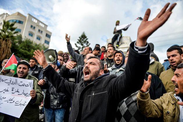 Palestinian workers in Gaza Cityprotest the Israeli blockade of Gaza on Dec.
