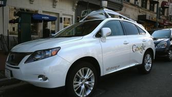 WASHINGTON, DC - APRIL 23:  Googles Lexus RX 450H Self Driving Car is seen parked on Pennsylvania Ave. on April 23, 2014 in Washington, DC. Google has logged over 300,000 miles testing its self driving cars around the country.  (Photo by Mark Wilson/Getty Images)