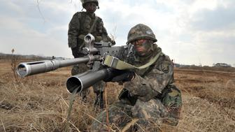 South Korean Army soldiers aim their weapons during a drill as part of annual joint exercises with the US, outside a US airbase in Pyeongtaek, south of Seoul, on March 14, 2013. The drill comes as North Korean leader Kim Jong-Un oversaw a live-fire artillery drill near the disputed sea border with South Korea, state media said on March 14 as the South's prime minister visited the flashpoint area.    AFP PHOTO / JUNG YEON-JE        (Photo credit should read JUNG YEON-JE/AFP/Getty Images)