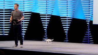 Facebook chief Mark Zuckerberg uses a small drone and an Oculus Rift virtual reality headset during a keynote presentation at the social network's annual developers gathering  in San Francisco on April 12, 2016     / AFP / Glenn CHAPMAN        (Photo credit should read GLENN CHAPMAN/AFP/Getty Images)