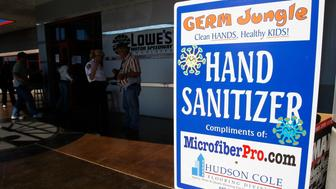 CONCORD, NC - OCTOBER 12: Complementary hand sanitizer is available in front of the media center after concerns of public health issues at events involving large gatherings were raised by The House Homeland Security Committee. The committee will be on a fact finding trip at the NASCAR Nextel Cup Series Bank of America 500 at Lowe's Motor Speedway on October 13, 2007 in Concord, North Carolina.  (Photo by Chris Graythen/Getty Images)