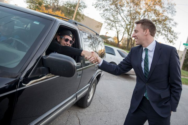 Democratic candidate for U.S. Senate in Missouri Jason Kander greets a voter on November 8, 2016 outside a polling place in K