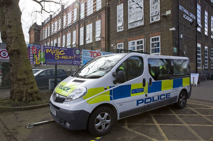A police vehicle is parked by London's Bethnal Green Academy, where three missing British school girls attended, on Feb. 23,