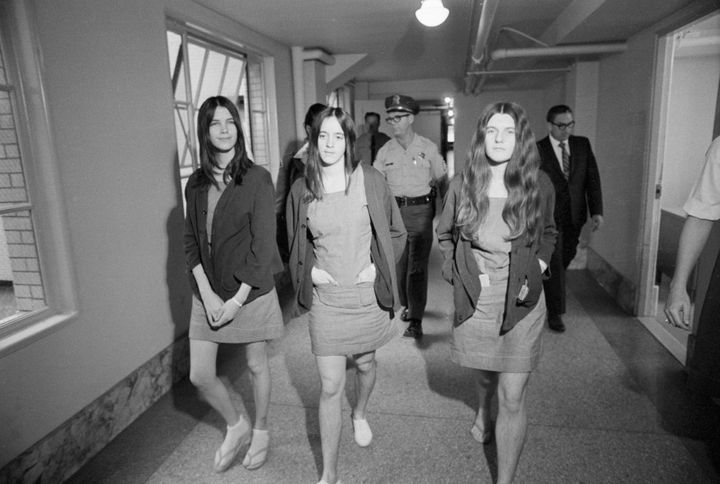 Leslie Van Houten, left, Susan Atkins and Patricia Krenwinkel walk from jail to a Los Angeles courtroom for their 1970 m