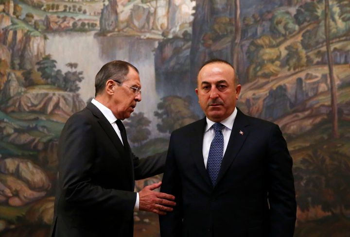 Russian Foreign Minister Sergei Lavrov, left, and his Turkish counterpart Mevlut Cavusoglu. The previous two Syria cease
