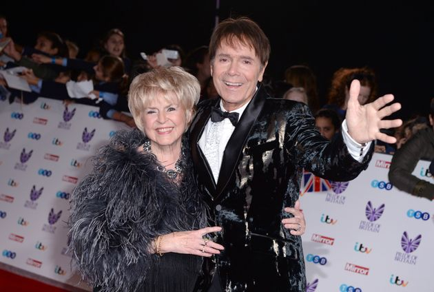 Cliff, here with friend Gloria Hunniford, is pressing on now with his