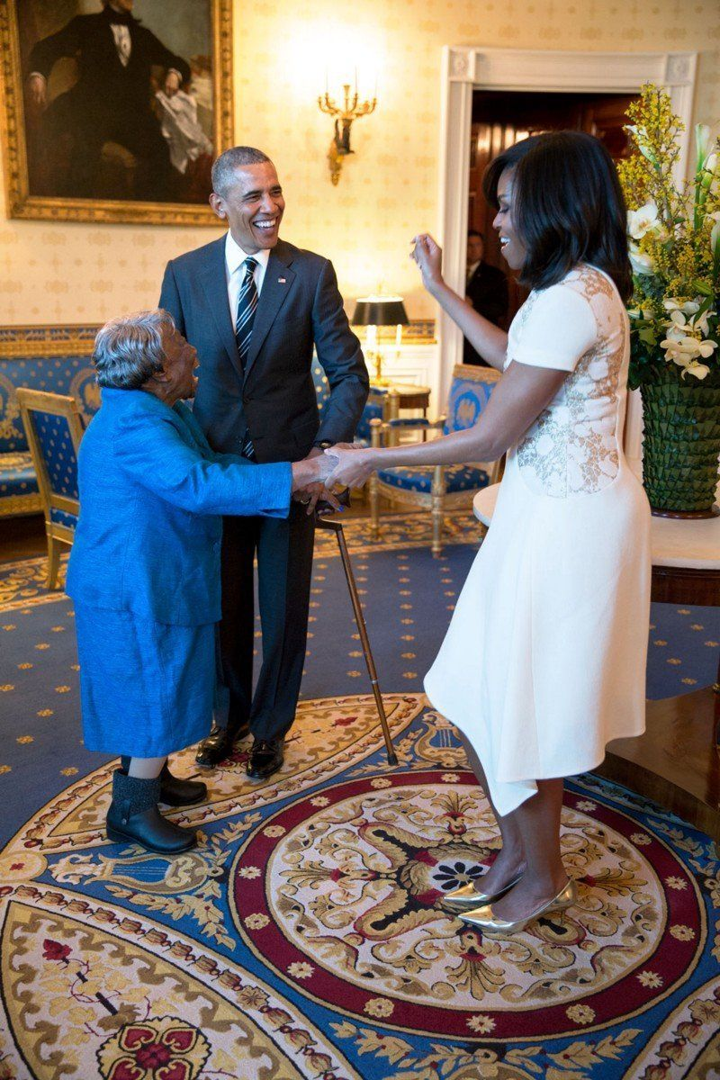 Obama watches the first lady dance with 106-year-old Virginia McLaurin in the Blue Room of the White House prior to a recepti