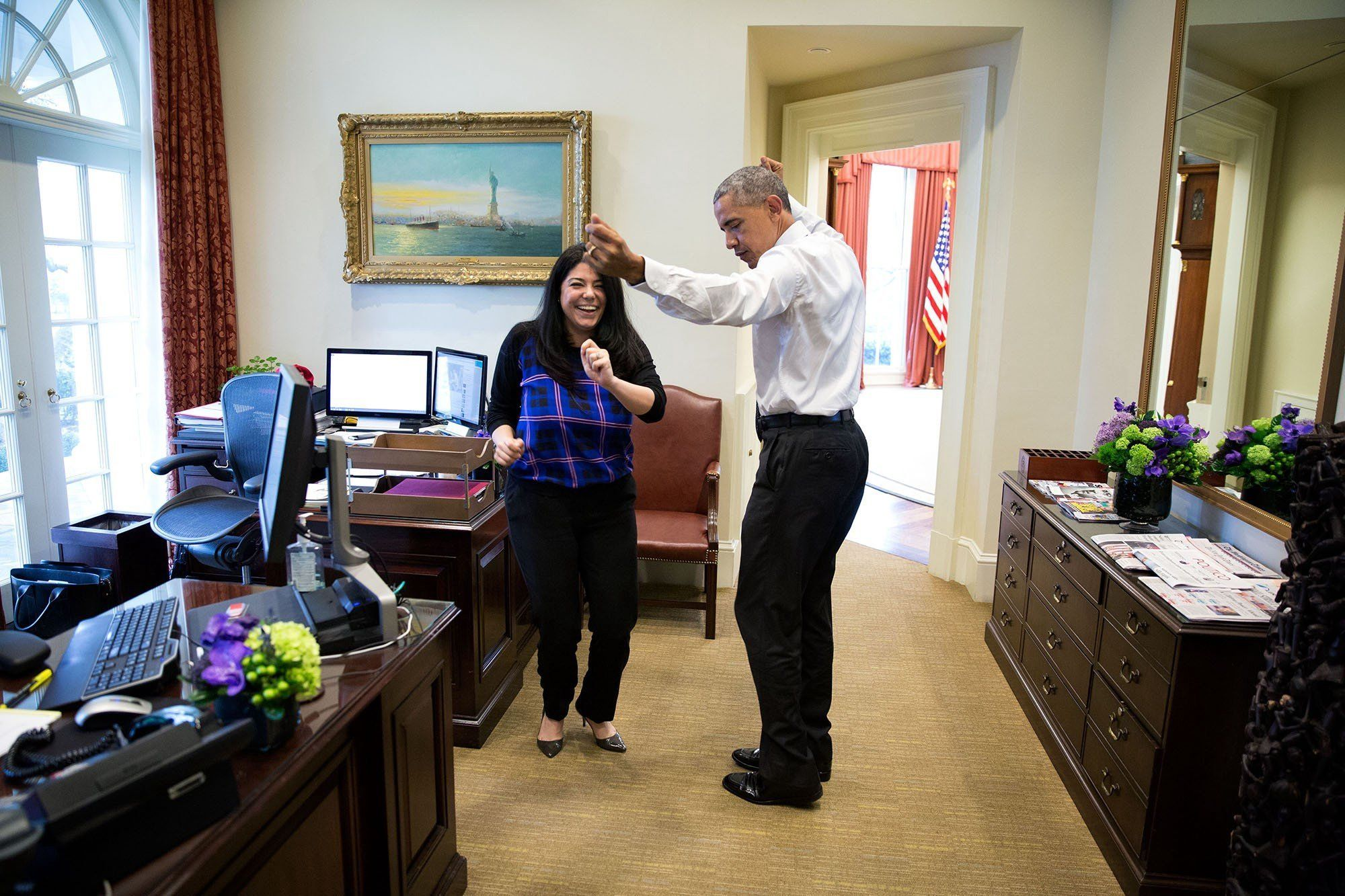 Obama dances in the Outer Oval with personal aide Ferial Govashiri on March 16
