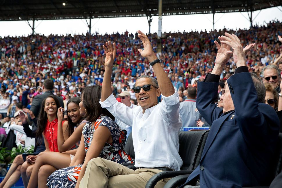 During an exhibition baseball game between the Tampa Bay Rays and the Cuban National Team in Havana, Cuba, Obama and Presiden
