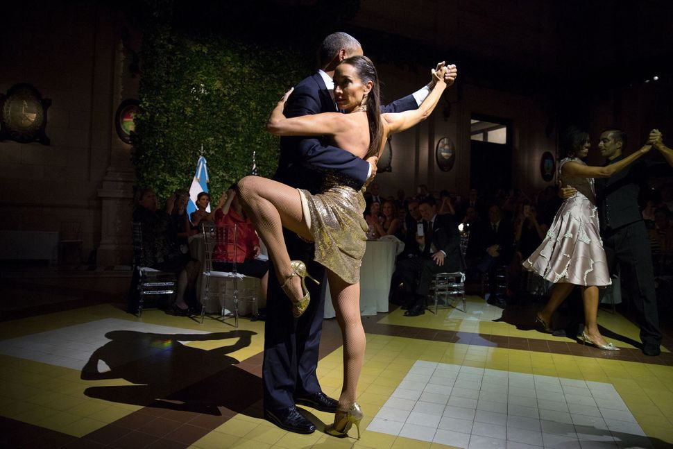 The president and first lady dance with renowned tango-dancers Mora Godoy and Jose Lugone in Buenos Aires on March 23.