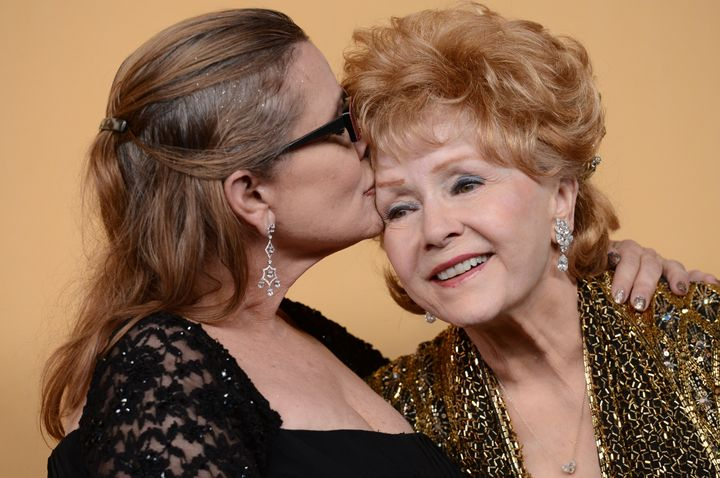 Debbie Reynolds and Carrie Fisher pose in the press room at the 21st Annual Screen Actors Guild Awards onJan. 25, 2015.
