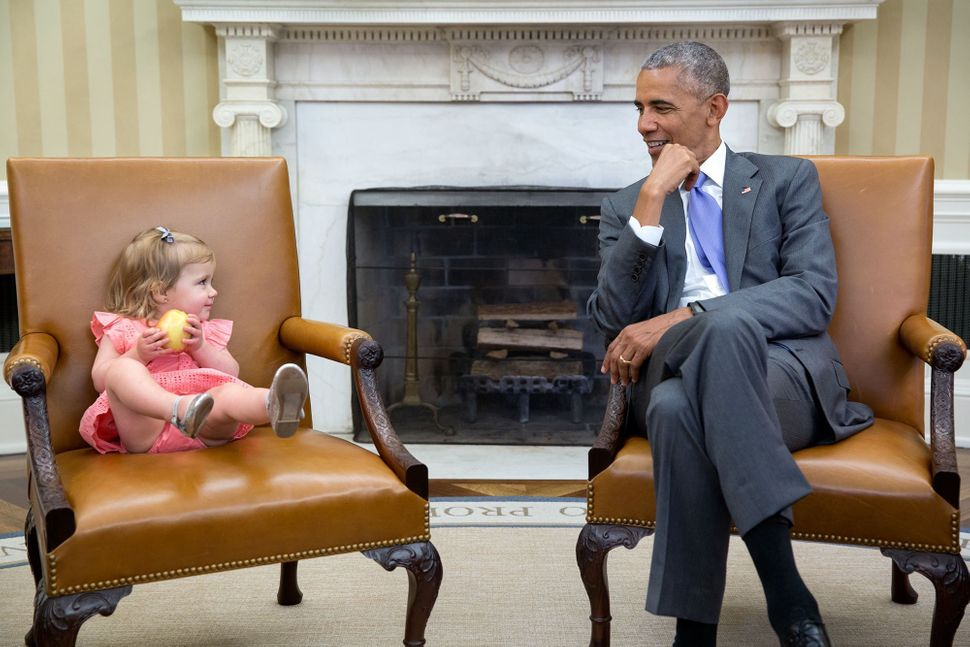 Obama chats with David Axelrod's granddaughter Maelin in the Oval Office on June 22.