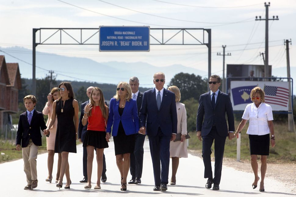 Biden family members head to a ceremony for a road near Camp Bondsteel U.S. Army base in Kosovo, which the Kosovan gover
