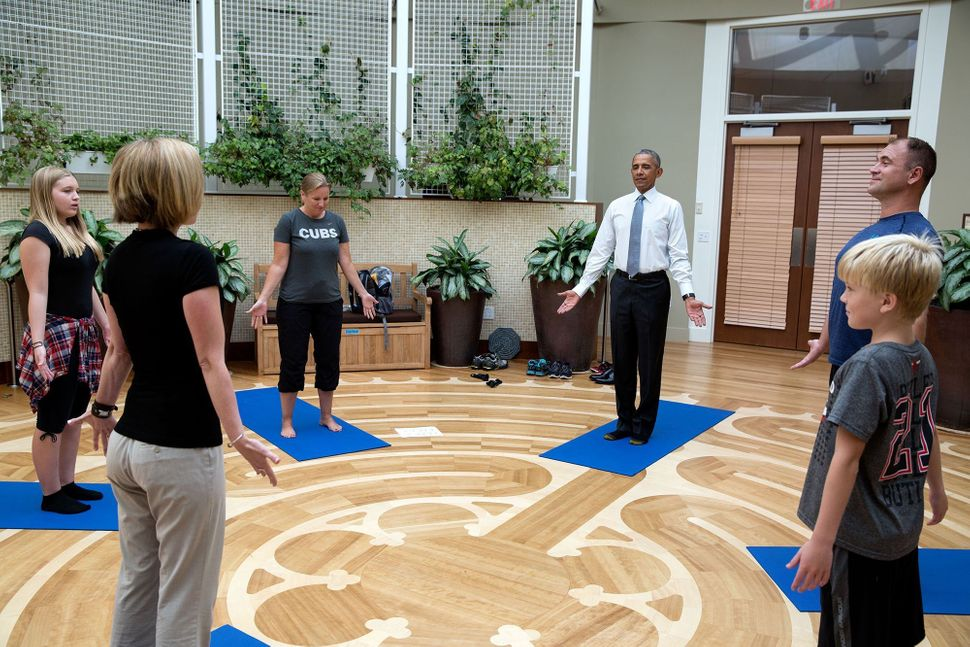 While visiting service members receiving therapy at the Walter Reed National Military Medical Center, Obama joins Master Chie