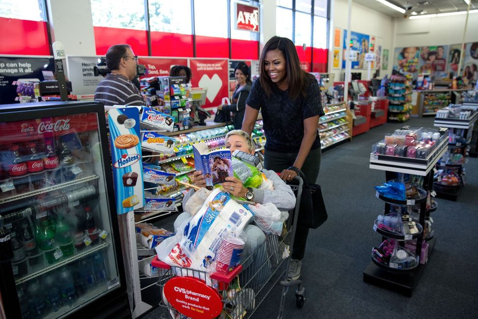 "The first lady goes shopping at a CVS Pharmacy in preparation for life after the White House during a segment taping for ""The"