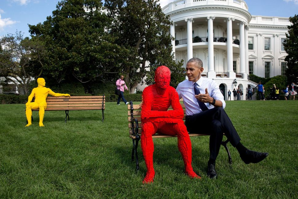 Obama poses with a Lego man sculpture during the South by South Lawn event hosted at The White House on Oct. 3.