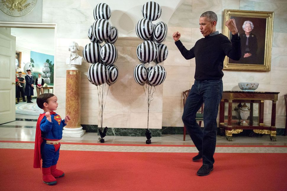 Obama flexes for Walker Earnest, son of White House press secretary Josh Earnest, during Halloween festivities at The White H