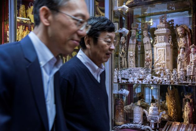 Members of the public walk past a shop selling ivory products in Hong Kong on Dec. 21. Hong Kong is a...