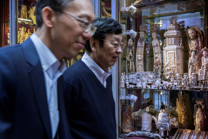 Members of the public walk past a shop selling ivory products in Hong Kong on Dec. 21. Hong Kong is a major transit hub for t