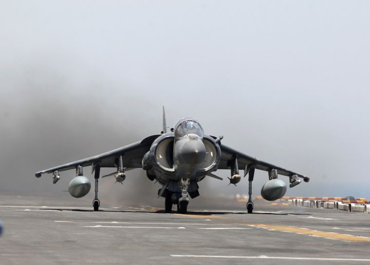 A AV-8B Harrier II from the 13th Marine Expeditionary Unit launches from the USS Boxer (LHD 4) during its first day of striki