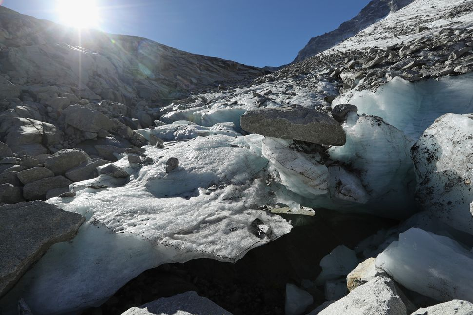 Large chunks of ice melt in the sun near the Hornkees glacier in Austria on Aug.26.