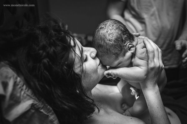 """The first embrace is one of my favorite moments to capture, especially after a hard first labor."""