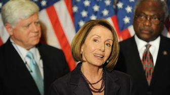 U.S. House Speaker Nancy Pelosi (D-CA) (C) is flanked by Rep. John Larson (D-CT) (L) and Rep. James Clyburn (D-SC) (R) as she holds a news conference after a Democratic Caucus meeting on Capitol Hill in Washington, November 17, 2010. Democrats in the House of Representatives voted on Wednesday to retain Pelosi as their leader when Republicans take control of the chamber in January.  REUTERS/Jonathan Ernst    (UNITED STATES - Tags: POLITICS IMAGES OF THE DAY)