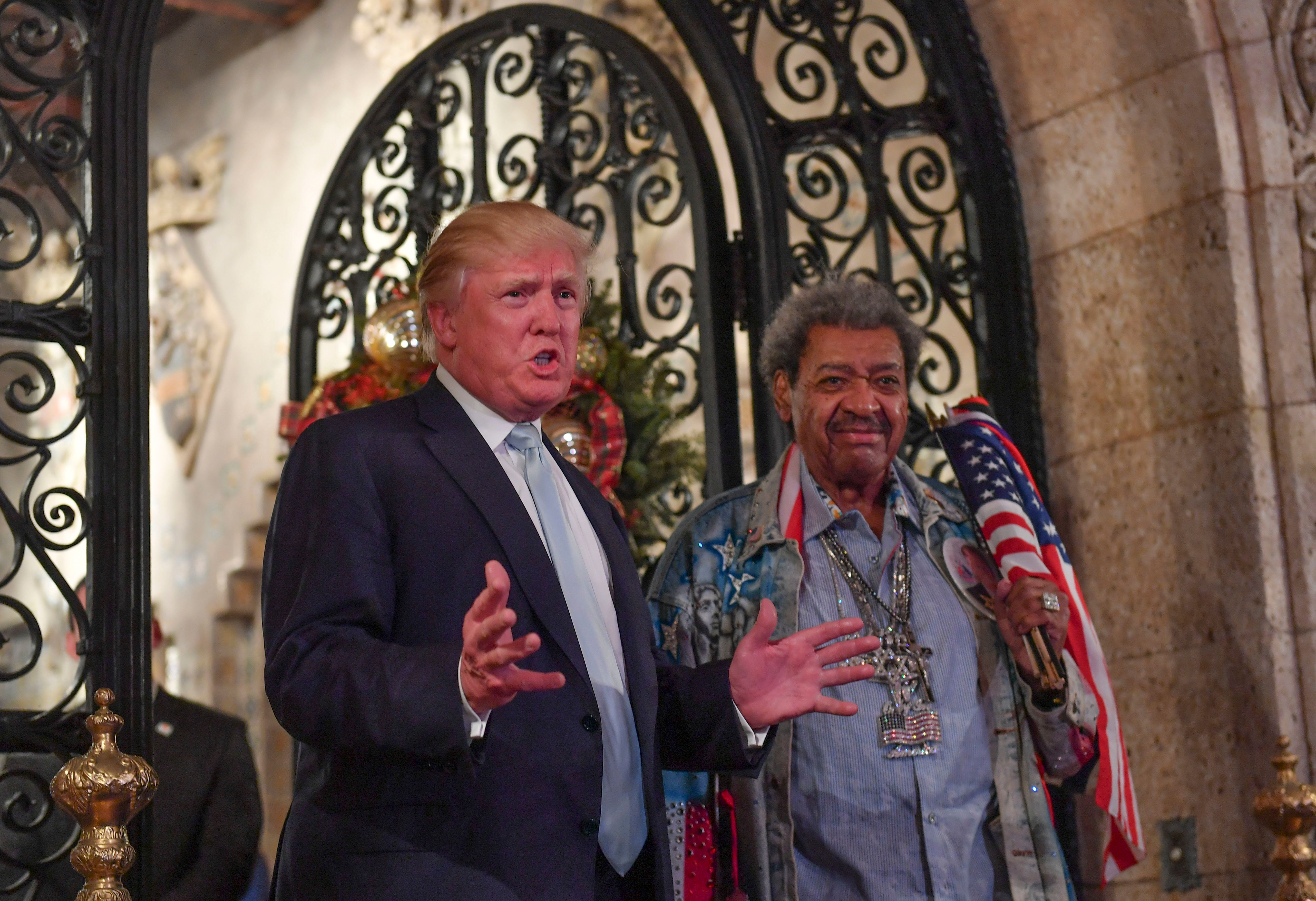 So many parties. Donald Trump stands with fight promoter Don King as they address the media during a...