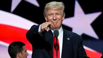 Republican presidential nominee Donald Trump points at the gathered media during his walk through at the Republican National Convention in Cleveland, U.S., July 21, 2016.  REUTERS/Rick Wilking/File Photo