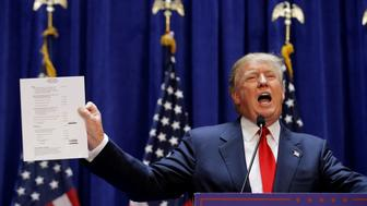 "U.S. Republican presidential candidate, real estate mogul and TV personality Donald Trump holds up his financial statement showing his net worth as he formally announces his campaign for the 2016 Republican presidential nomination during an event at Trump Tower in New York June 16, 2015.   REUTERS/Brendan McDermid/File Photo                  FROM THE FILES PACKAGE ""THE CANDIDATES"" - SEARCH CANDIDATES FILES FOR ALL 90 IMAGES"