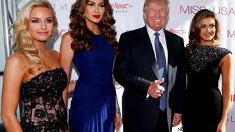 (left to right) Miss Teen USA 2013 Cassidy Wolf, Miss Universe 2013 Gabriela Isler, Donald Trump, and Miss USA 2013 Erin Brady pose during a red carpet event before the Miss USA 2014 pageant in Baton Rouge, La., Sunday, June 8, 2014. (AP Photo/Jonathan Bachman)