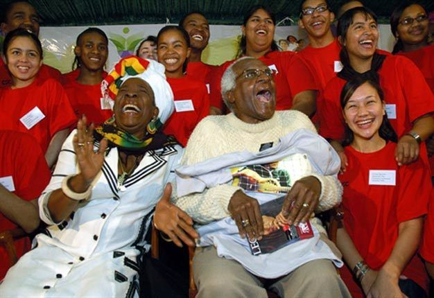 <em>Desmond Tutu shares a laugh with Rita Marley, wife of Bob Marley, during a meeting with 20 young people.</em>