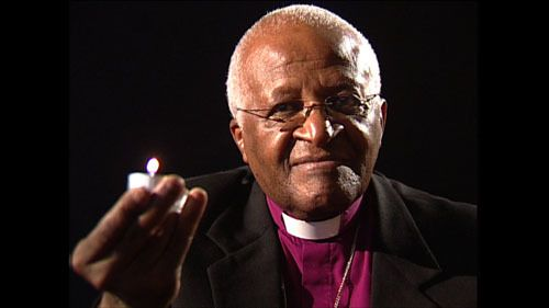 <em>Archbishop Tutu lights a candle for the survivors of genocide in Rwanda.</em>