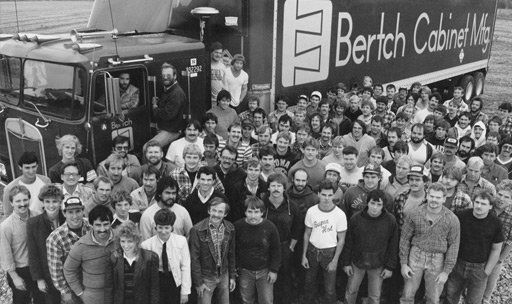 Some of the happy workers of Bertch Cabinets outside the plant in Waterloo, Iowa.