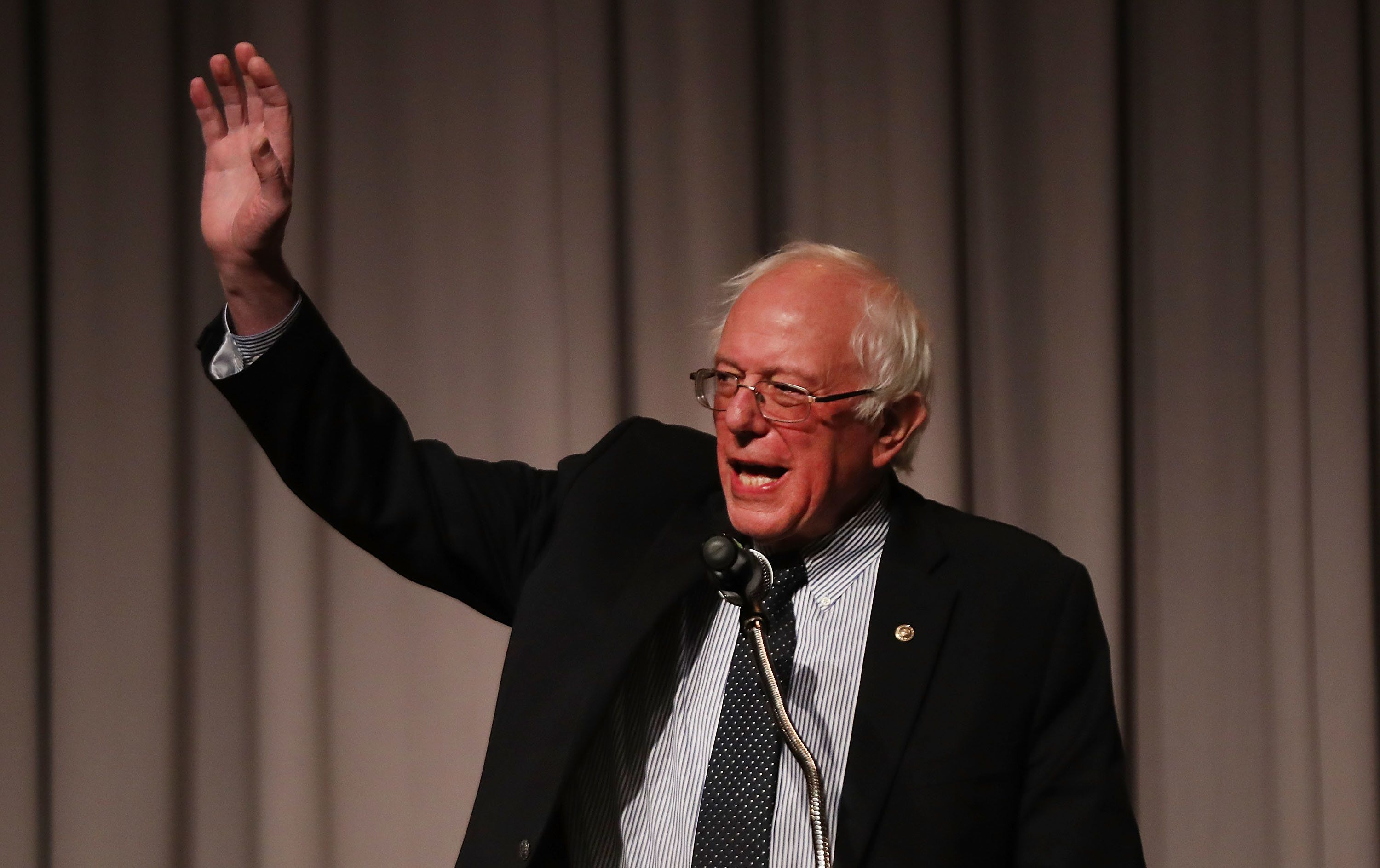 NEW YORK, NY - DECEMBER 13:  Former presidential candidate and Vermont Senator Bernie Sanders waves to the audience gathered to hear him speak at The Cooper Union on December 13, 2016 in New York City. Sanders also spoke about Donald Trump's win in the 2016 Presidential election and his new book, Our Revolution: A Future to Believe In. (Photo by Spencer Platt/Getty Images)