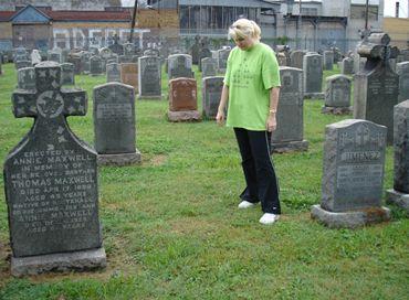 <em>                             Megan Smolenyak with Annie's unmarked plot at Calvary Cemetery, August 2006</em>