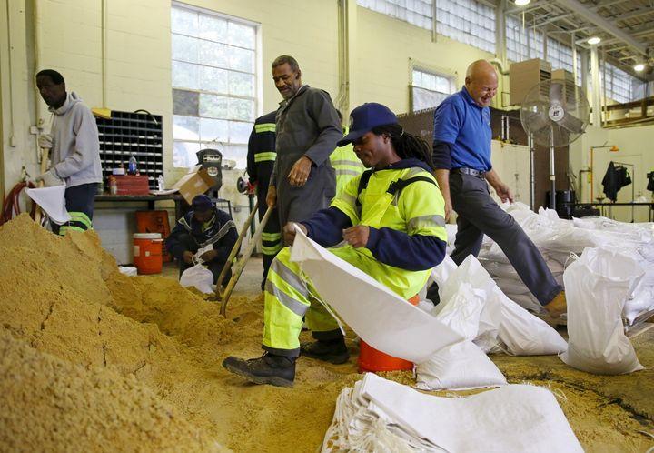 Alexandria, Virginia, public works employees load sandbags after Hurricane Joaquin battered the Bahamas.