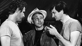 Wayne Rogers as Trapper John, William Christopher as Father Mulcahy, and Alan Alda as Hawkeye in a scene from the long-running US television series M*A*S*H (1972-1983) about a US Army medical surgical unit during the Korean War.