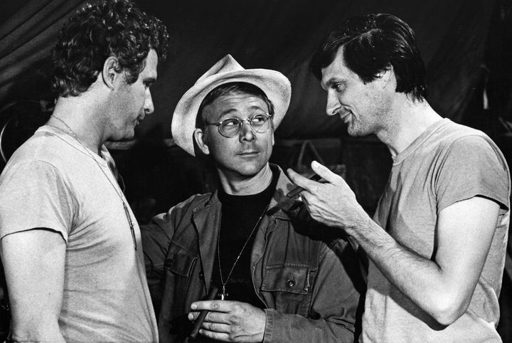 """William Christopher, center, as Father Mulcahy on """"M.A.S.H."""" surrounded by co-starsWayne Rogers as Trapper John (left)"""