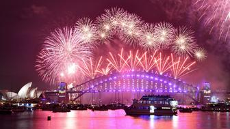 Fireworks erupt over Sydney's iconic Harbour Bridge and Opera House during the New Years Eve fireworks show in Sydney on January 1, 2017. / AFP / PETER PARKS        (Photo credit should read PETER PARKS/AFP/Getty Images)