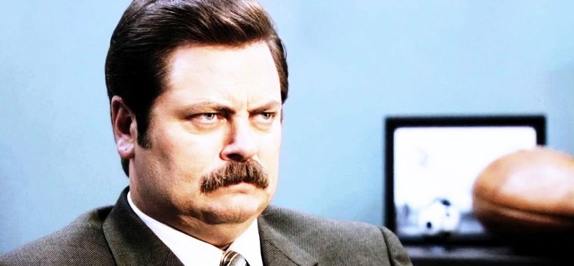 <em>Parks and Recreation</em>'s Ron Swanson(Nick Offerman) scowls uncomfortably.